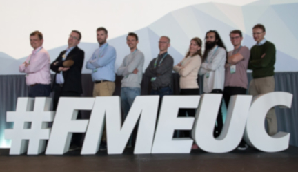 Group of people infront of FMEUC sign